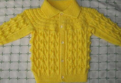 宝宝连体衫    宝宝连体背心的编织方法这件比较简单,从下往上织,起