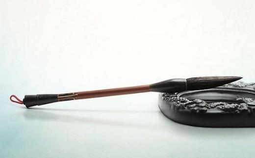 中国传统的书写工具毛笔是谁发明的